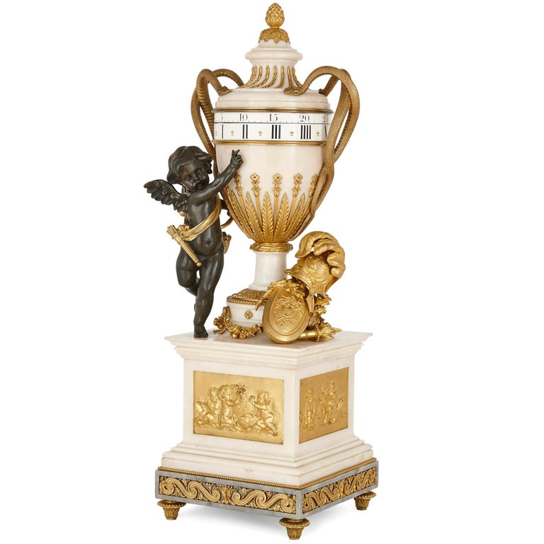Large neoclassical style marble and gilt bronze circular movement mantel clock French, late 19th century Measures: Height 82cm, width 26cm, depth 26cm  Crafted from the finest of materials, including beautiful white marble, gilt bronze, and