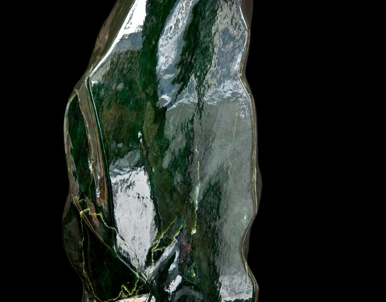 This magnificent piece of Nephrite Jade is currently one of the statement pieces in our showroom. Dark inky-green hues, smooth texture, sculpture-like shape and a colossal 70cm in height make it the perfect showpiece for any interior. It has a