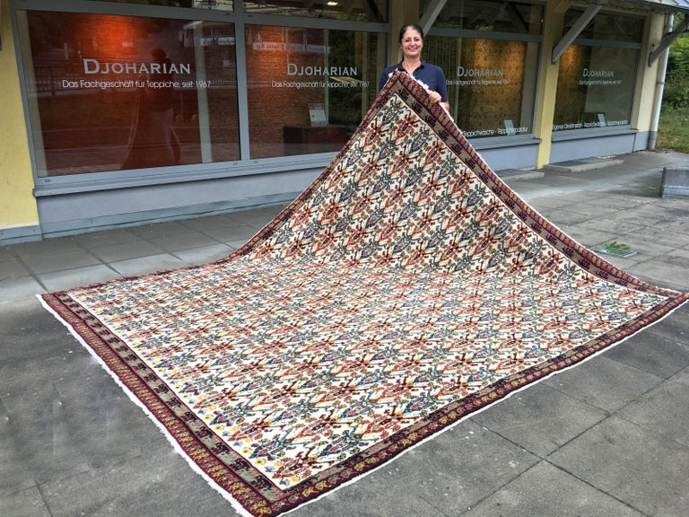 Very nice and unusual large tribal North African / Moroccan Berber rug. Nice and soft handspun wool, hand-knotted and plush pile. Vibrant colors beige, purple, gold, green, pink, blue. Very good vintage condition and squares size.