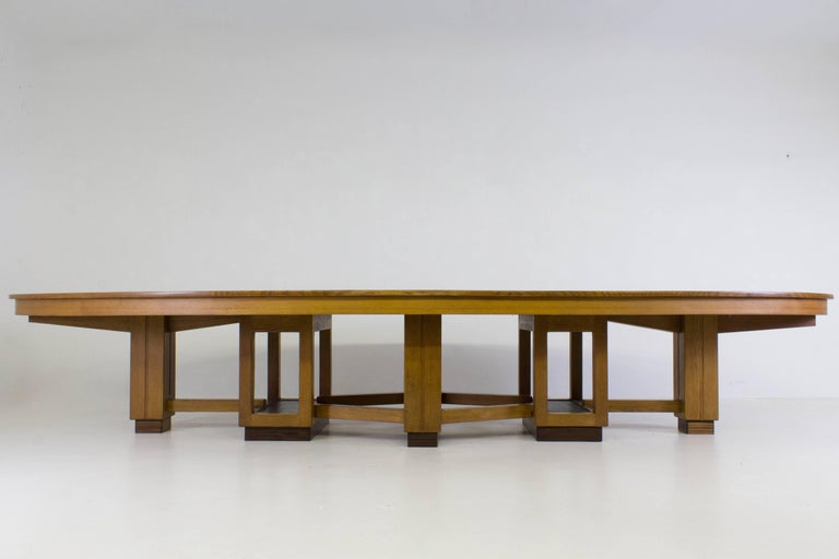 Large and rare oak Art Deco Haagse school conference table, 1920s. Oval shaped black lacquered linoleum top. Solid oak base in five segments with Macassar ebony veneer. The black lacquered top has one minor spot. In good original condition with