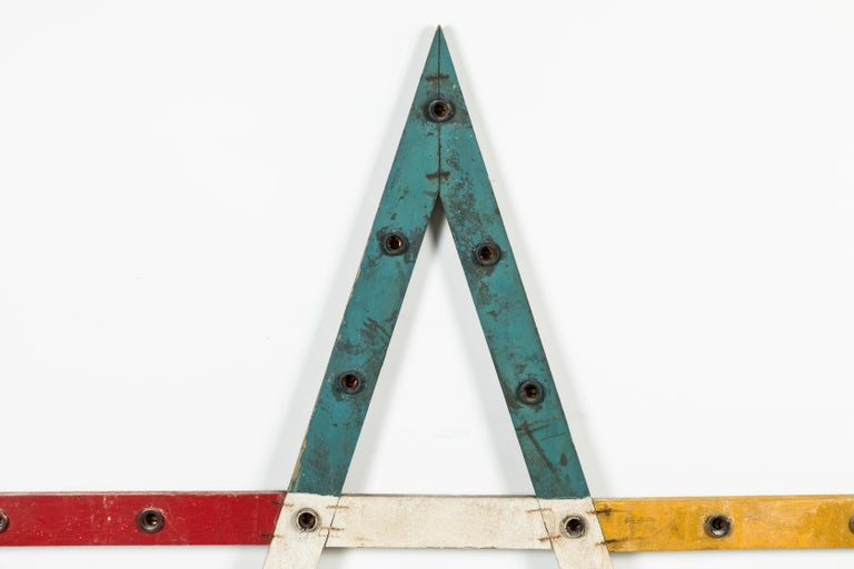 Vintage wood painted odd fellows lodge star. Original paint surface. Iron staple construction. Original wiring and sockets in tact.   We have not tested wires or sockets and make no guarantees about condition of wiring.