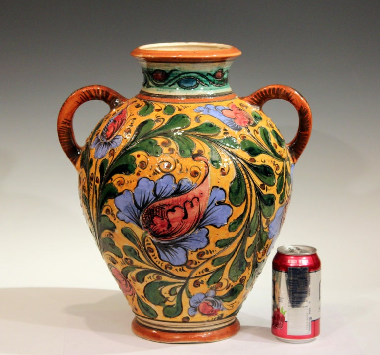 Large old or antique hand-turned Italian Pottery sgraffito Majolica vase with vibrant floral scrolls, circa early 20th century. Signed on base. 15 1/2