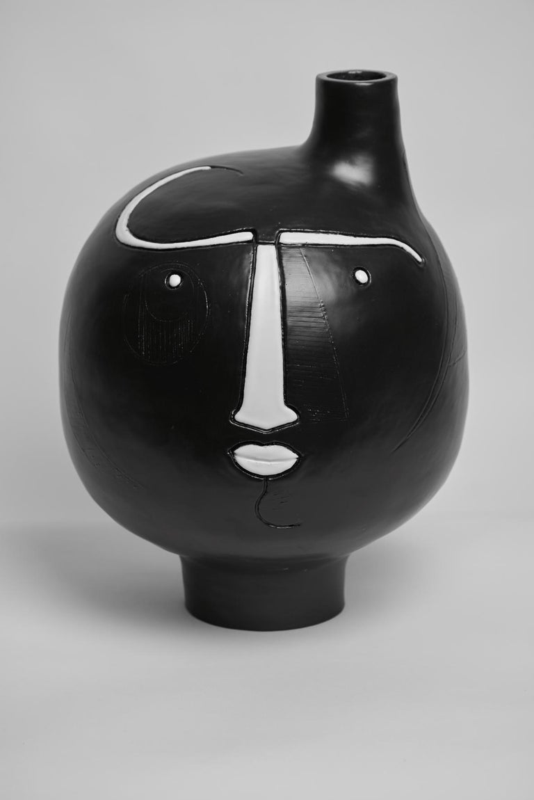Large hand-sculpted ceramic base lamp, stylized face with engraved lines , stoneware glazed in black and white enamel.  One of a kind handmade piece signed by the French ceramicists Dalo , 2018  The height dimension is for the ceramic sculpture
