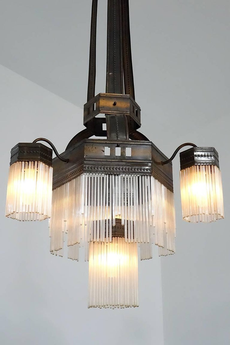 You can call this distinctive lamp Jugendstil or Art Nouveau and the look is amazing. The style is very distinctive. This lamp has all of its hand blown hollow glass rods with no damage, and there are at least 300 of them. The darkened copper finish