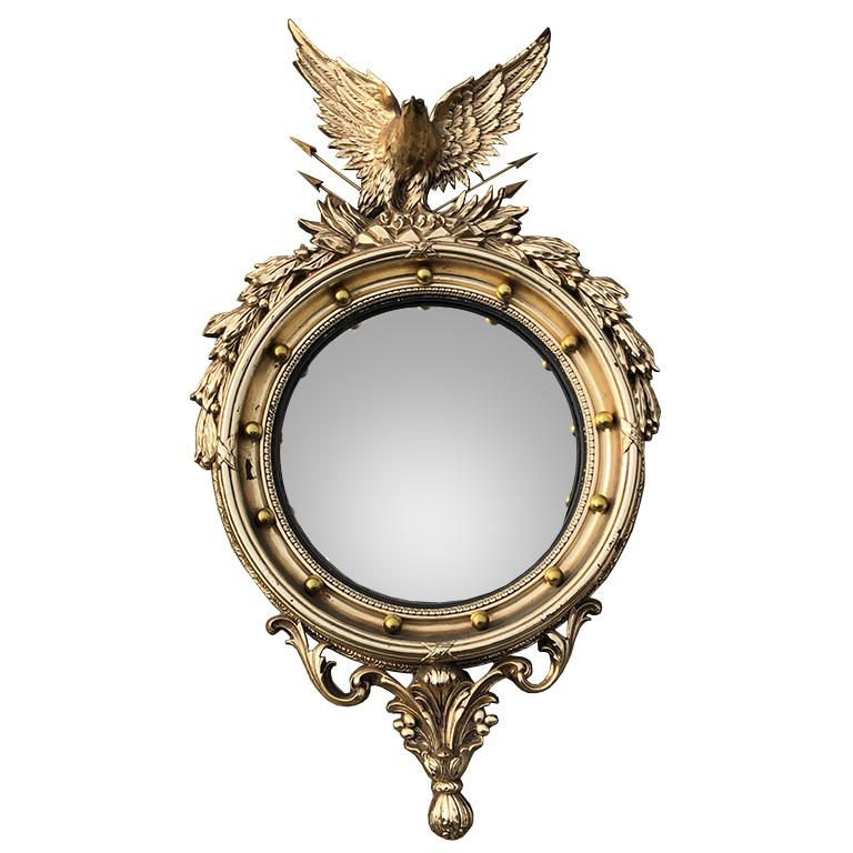 Classic Federal style extra large eagle mirror.   The 13 balls surrounding the mirror is said to represent the original colonies. Sometimes called a fish eye mirror, this convex mirror has intricate details. The eagle at the top grasps a quill of