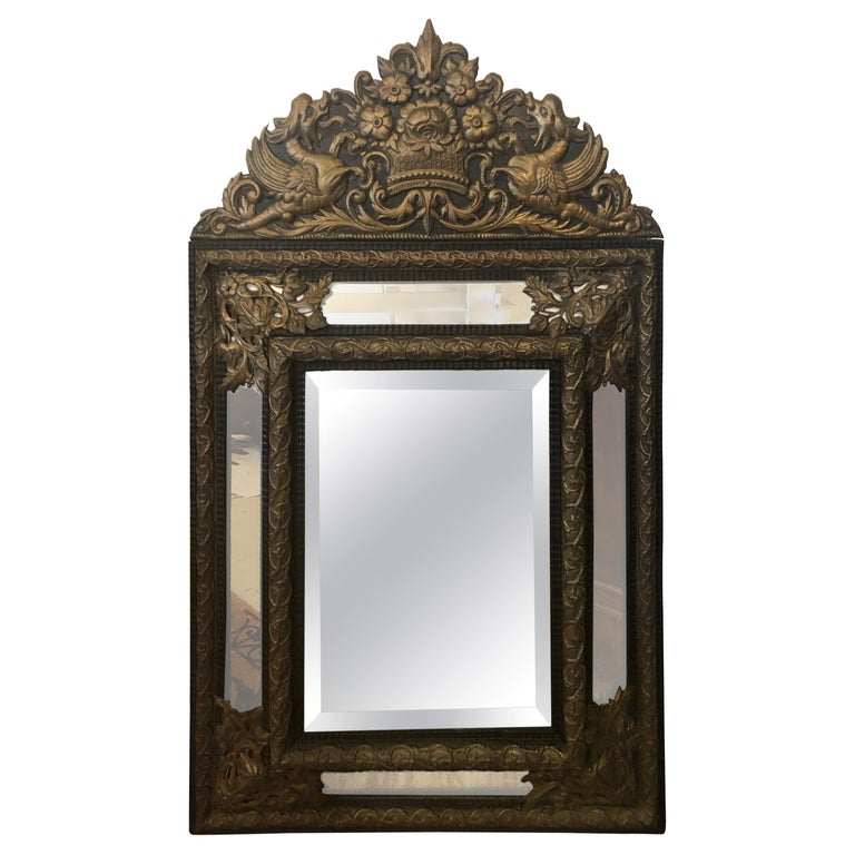 Large Ornate Repousee Brass and Ebonized Cushion Mirror For Sale
