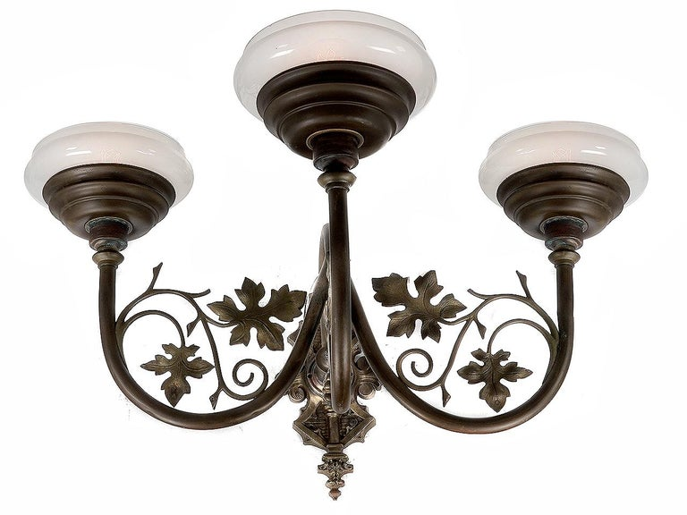 This is a large and impressive ornate sconce that makes a big statement. The Vaseline glass has a nice mellow grapefruit color and the hand blown glass is light and delicate. The metal is an intricate combination of curved tubing and floral work.