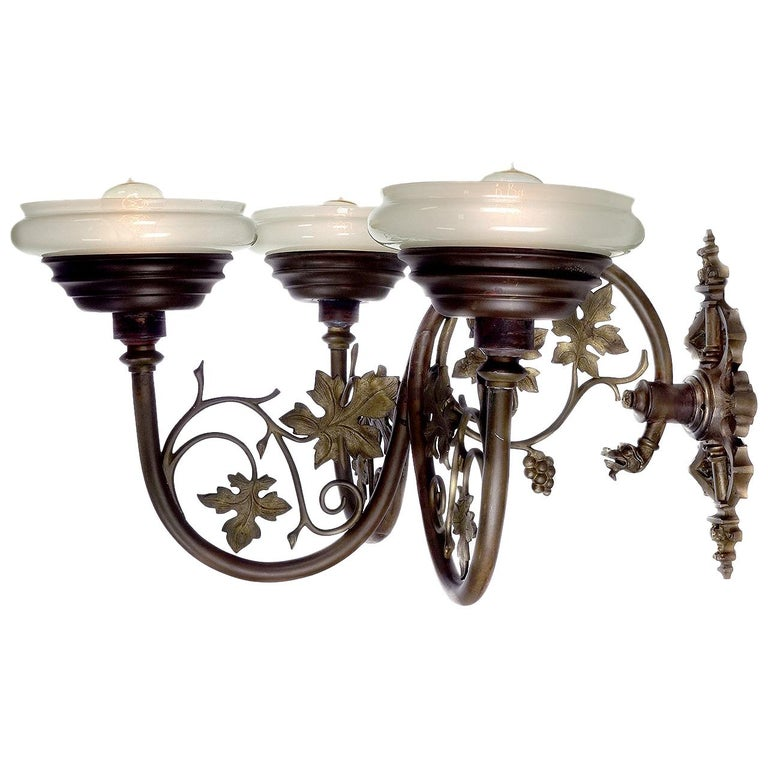 Large Ornate Triple Vaseline Glass Sconce For Sale