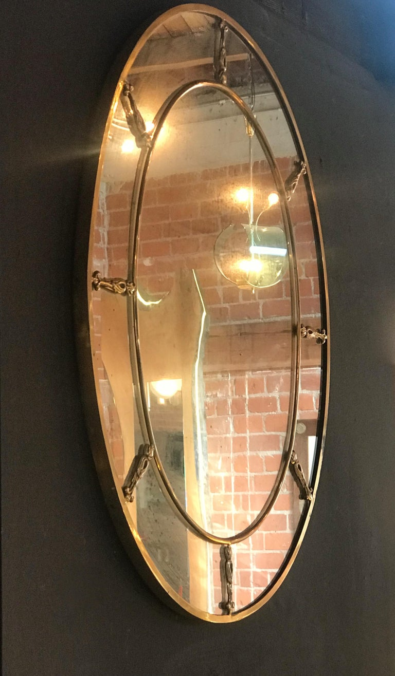 Italian Large Oval Art Deco Mirror with Brass Decorations, Italy, 1930s For Sale