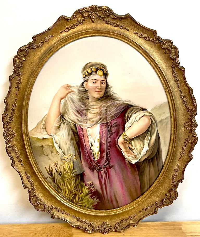 Large oval Berlin (K.P.M.) Porcelain plaque of a harem dancer Exceptional painting of a veiled exotically dressed and jeweled dancer, in landscape.  Impressed K.P.M. and scepter mark to reverse, with other factory marks. Plaque: 17 H x 13 1/2 W