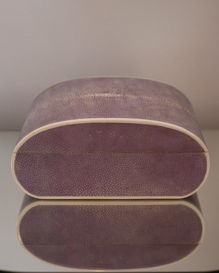 A semi round oval lavender Shagreen decorative box finished with bone, sycamore and a felt interior. Maison Nurita's Shagreen boxes are more than just decorative, they can be a special place to hold your coveted jewelry, love letters or sentimental