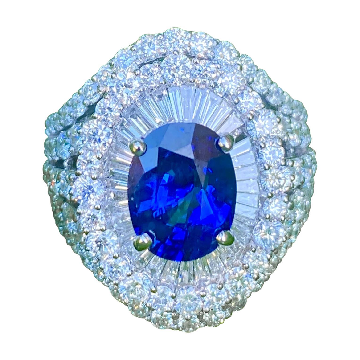 Large Oval Shaped Vivid Blue Sapphire and Diamond 7.20 Carat 18 Karat Gold Ring