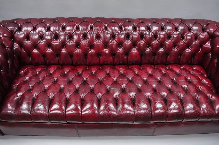 Large Oxblood Burgundy Red Leather Button Tufted Chesterfield Sofa In Good Condition For Sale In Philadelphia, PA