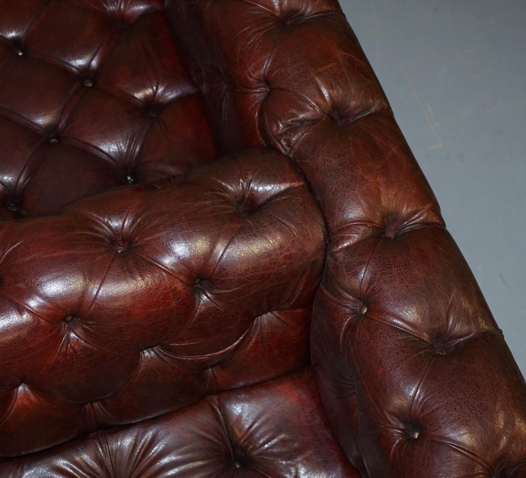 Large Oxblood Vintage Leather Double Sided Chesterfield Tufted Conversation Sofa For Sale 6