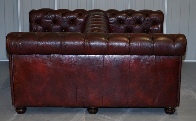 Large Oxblood Vintage Leather Double Sided Chesterfield Tufted Conversation Sofa For Sale 8