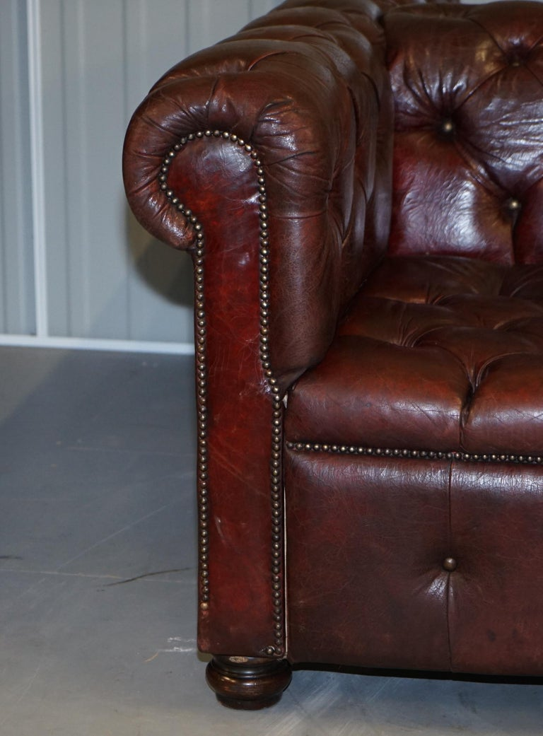 Large Oxblood Vintage Leather Double Sided Chesterfield Tufted Conversation Sofa For Sale 10
