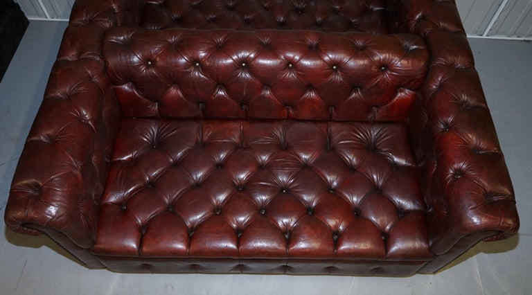 Large Oxblood Vintage Leather Double Sided Chesterfield Tufted Conversation Sofa For Sale 12