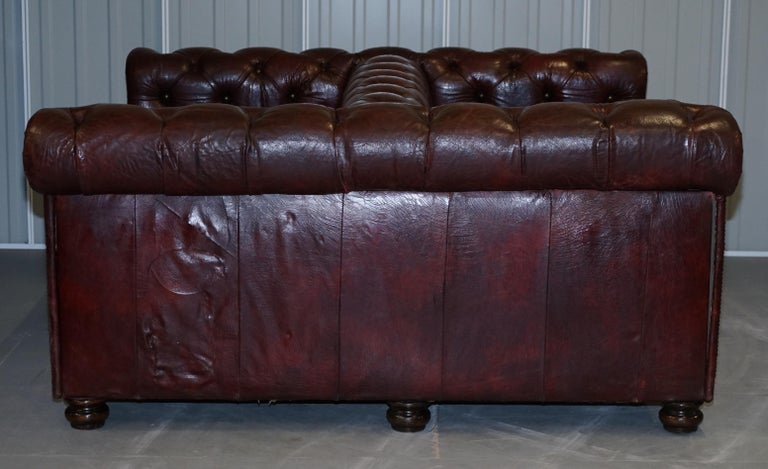 Large Oxblood Vintage Leather Double Sided Chesterfield Tufted Conversation Sofa For Sale 14