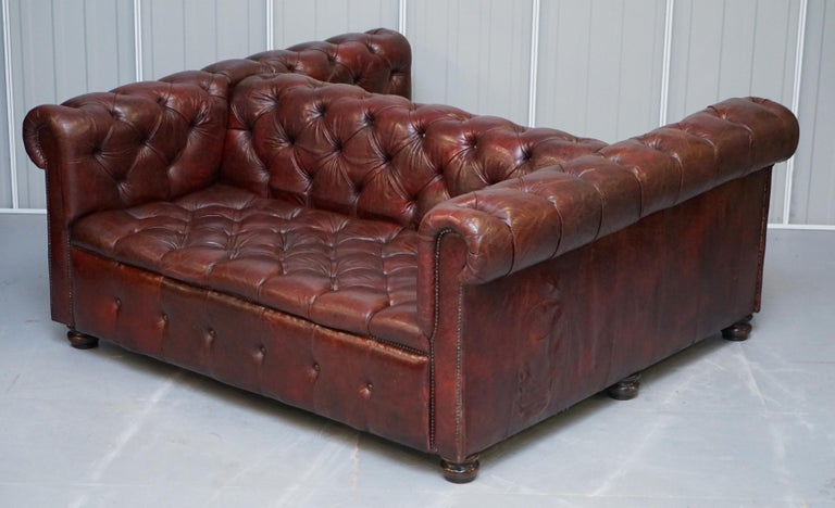 English Large Oxblood Vintage Leather Double Sided Chesterfield Tufted Conversation Sofa For Sale