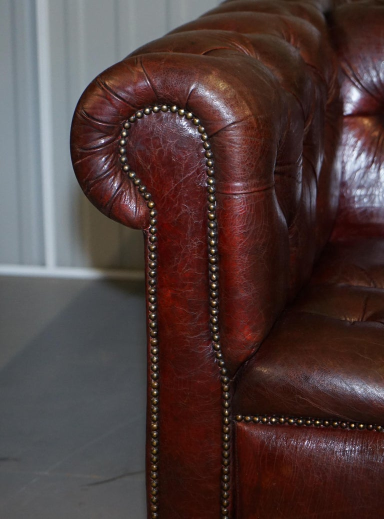 20th Century Large Oxblood Vintage Leather Double Sided Chesterfield Tufted Conversation Sofa For Sale