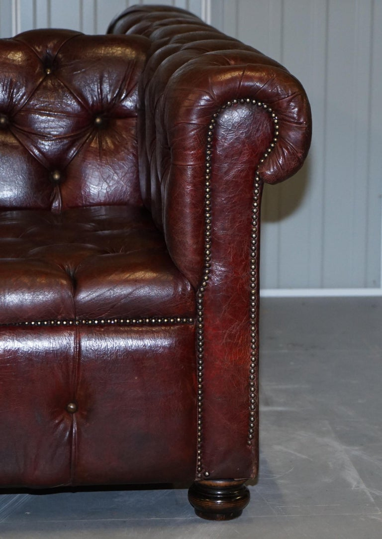 Large Oxblood Vintage Leather Double Sided Chesterfield Tufted Conversation Sofa For Sale 2