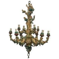 Large Painted Wooden Chandelier Decorates a Tree Adorned with Foliage and Birds