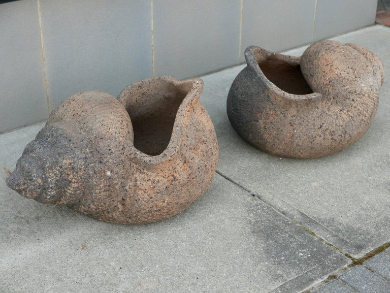 A stunning set of large 1930s terracotta shell-shaped planters with gorgeous age acquired patina. Most likely from a large resort as I've never seen anything like this before.