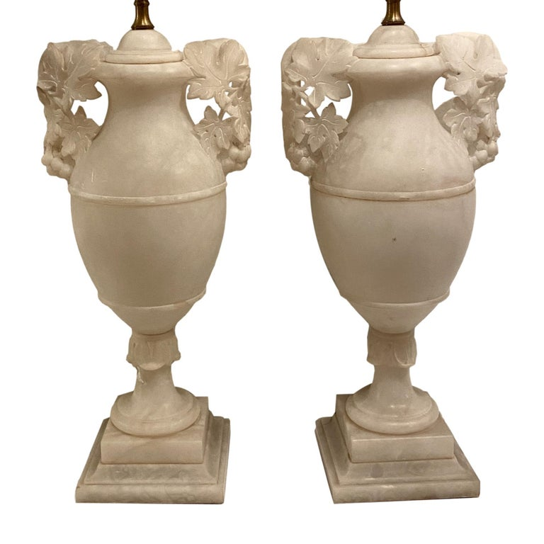 Pair of circa 1920's French carved alabaster table lamps with foliage motif open-work carved handles.