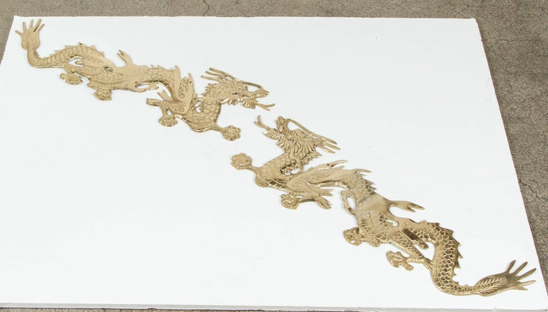 Large wall mount pair of dragons chasing a ball. Dragons chasing a ball is the auspicious scene of good luck, prosperity and wealth. It is believed that displaying dragon statue at home/office can attract auspicious energy.  The ball here is the