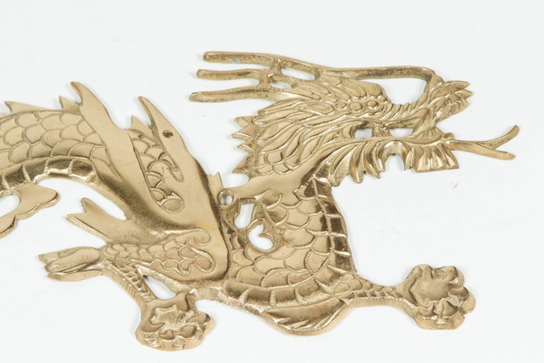Chinese Large Pair of Asian Cast Brass Dragons Chasing a Ball Wall Mount For Sale