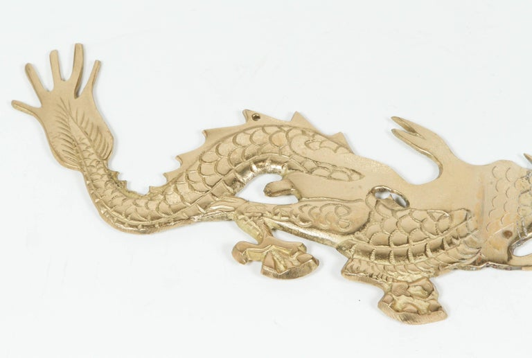 Large Pair of Asian Cast Brass Dragons Chasing a Ball Wall Mount In Good Condition For Sale In Los Angeles, CA