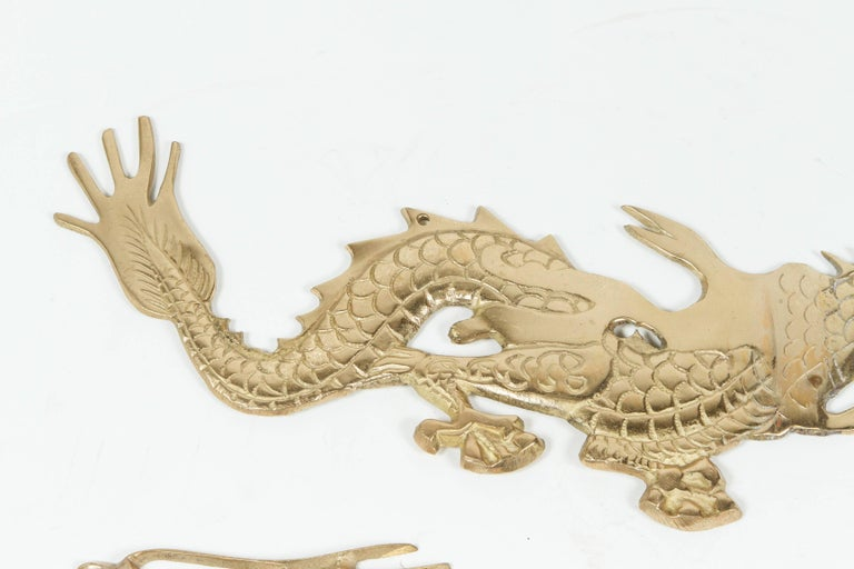 Large Pair of Asian Cast Brass Dragons Chasing a Ball Wall Mount For Sale 1