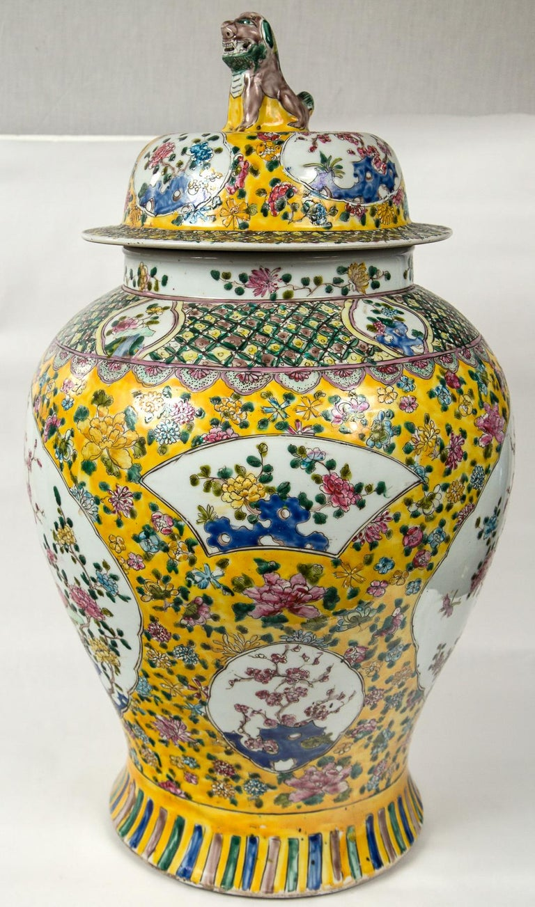 Yellow ground, hand painted patterns and designs foo dog form finial atop lids.