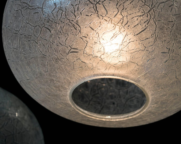 An excellent pair of Doria frosted crackled glass pendant lights. Height can be adjustable.
