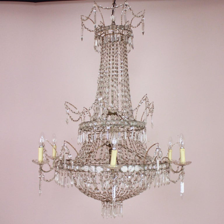 Large Pair of Spanish Empire Style 7-Light Crystal-Cut Chandeliers  A large pair of Empire style 7-light crystal-cut chandeliers made in the Spanish Royal Factory of Glass and Crystal of La Granja: Real Fábrica de Cristales de La Granja. Established
