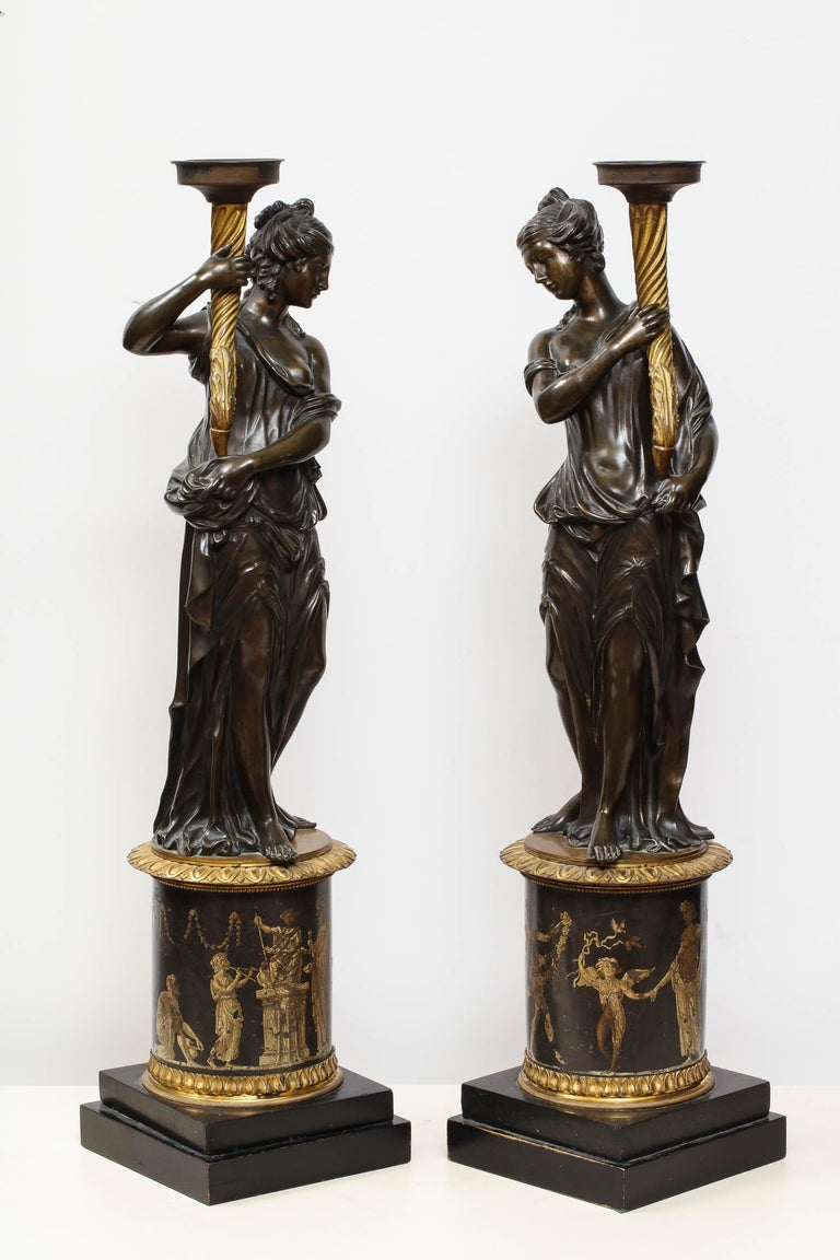 Large Pair of French Gilt and Patinated Bronze Figural Candleholders In Excellent Condition For Sale In New York, NY