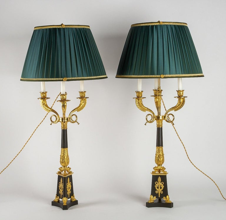 Large pair of French Restauration period candelabra converted in table lamps.