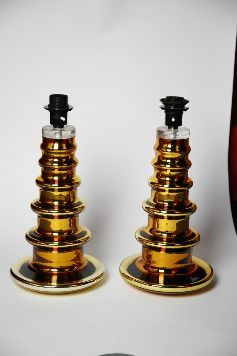 An outstanding large pair of gold glass cased table lamps by Flygsfors, Sweden, 1970. Flygsfors was one of the most famous glass manufacturers of Sweden.  Rewired for the US.