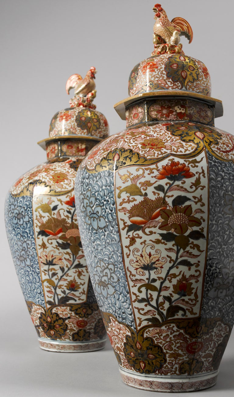 Porcelain, decorated with underglaze blue lotus and vine and the overglaze colors iron-red and gold. Large oviform, octagonal baluster jar on footring, recessed base. Wide upright neck. High domed cover with wide everted rim and hen and chicks