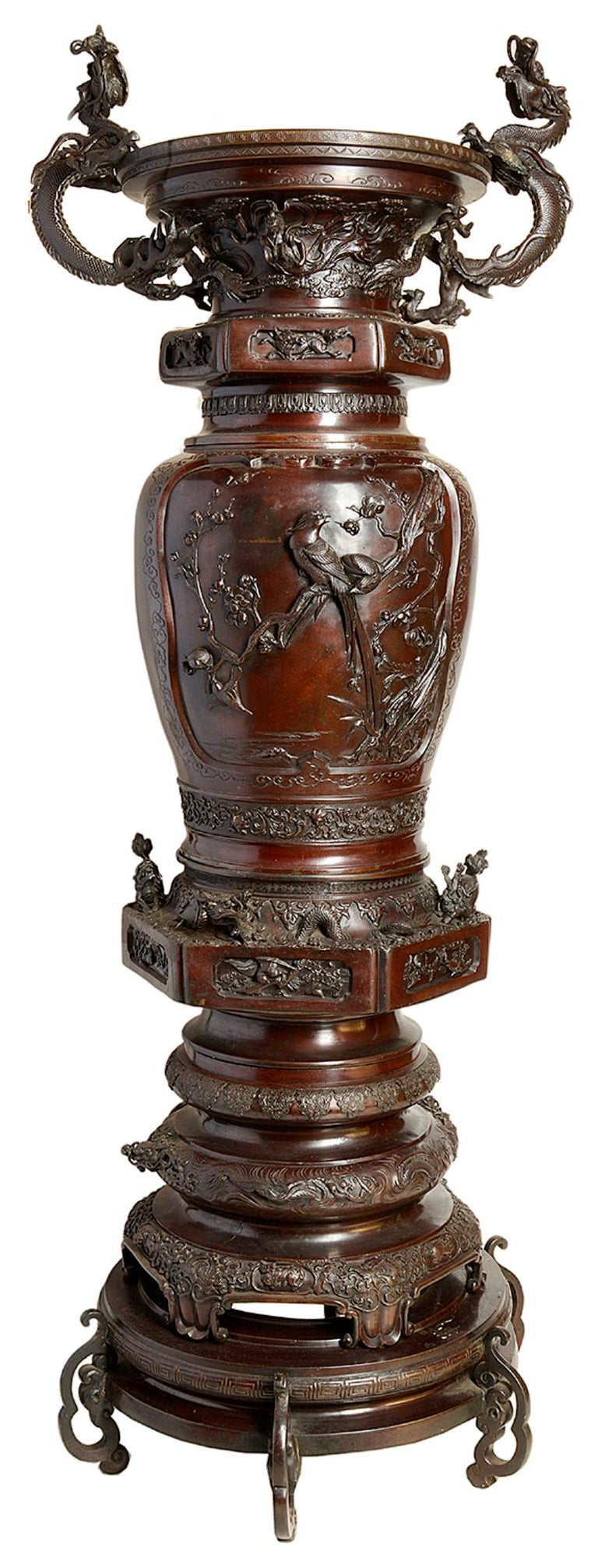 A very impressive, good quality pair of Japanese Meiji period (1868-1912) bronze two handled vases. Each have wonderful classical scenes of flowers and birds, surrounded by mythical dragons and motifs.