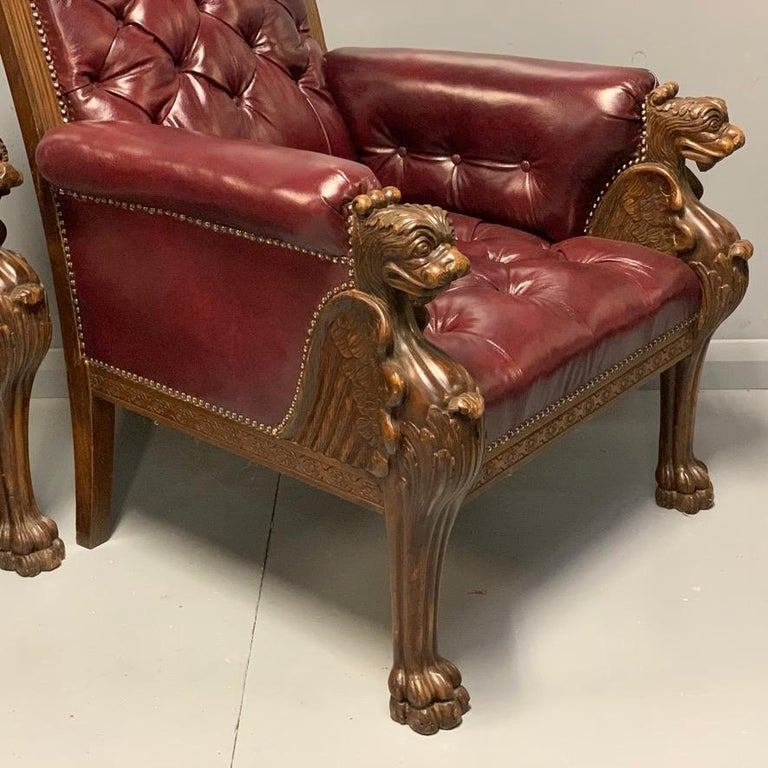 Large Pair of Mid-19th Century European Buttoned Leather Armchairs with Griffins In Good Condition For Sale In Uppingham, Rutland