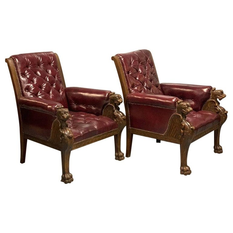 Large Pair of Mid-19th Century European Buttoned Leather Armchairs with Griffins For Sale