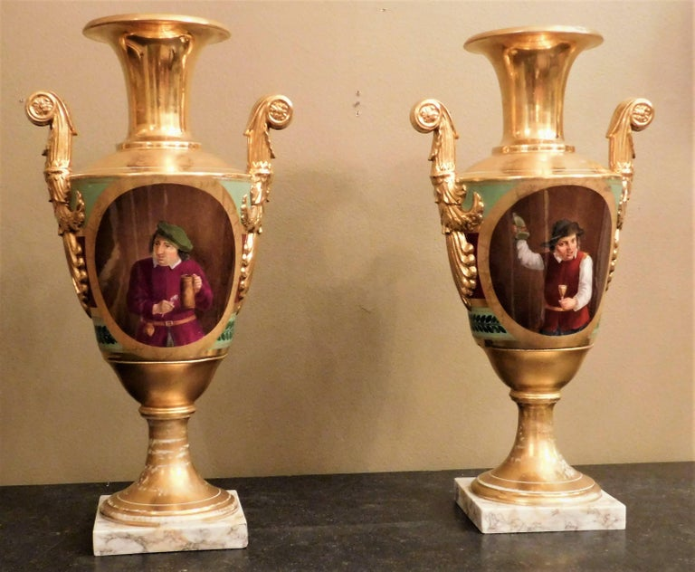 This pair of neoclassic Vieux Paris conical shaped vases have Classical Roman motifs on one side. Portraits on the other side depict an inebriate on one vase and a teetotaler on the other vase. Gilt contrast burnished gold decoration and poly chrome