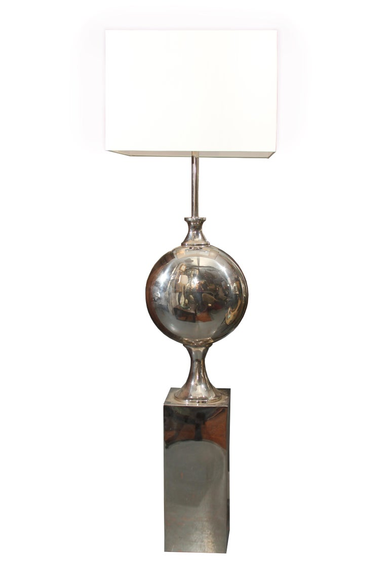 Large dramatic chrome floor lamps with large square linen shades these function as sculpture as well as task lighting. Shades measure 20 x 20 x 14 tall.