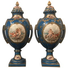 Large Pair of Sevres Style Painted and Raised Gilt Porcelain Urns