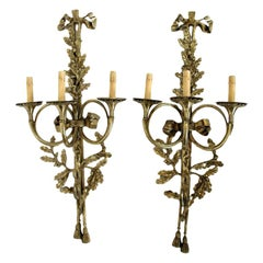 A Large Pair of Solid Brass Three-Arm Trumpet Form Wall Sconces