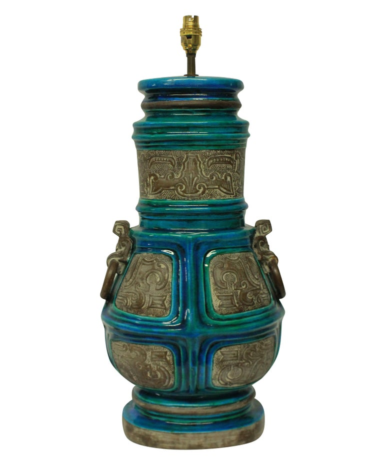 A pair of large Italian table lamps by Ugo Zaccagnini, in part glazed and part bisque glazed ceramic in turquoise blue, each hand numbered.