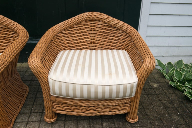 Large and comfortable pair of 1980s vintage Ficks Reed rattan / reed or wicker arm chairs. Stunning looking from every angle. Substantial and well made.