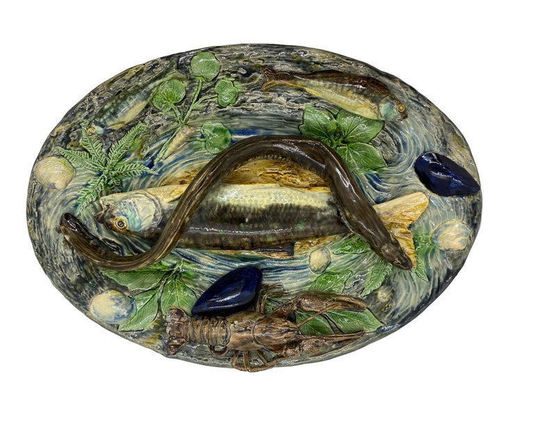 Large Plalissy ware Majolica Trompe L'oeil Platter by Alfred Renoleau (French 1854-1930), circa 1885. Naturalistically molded and applied with a large fish and eel to the center, a lobster, and various smaller fish to the rim, with mussels and