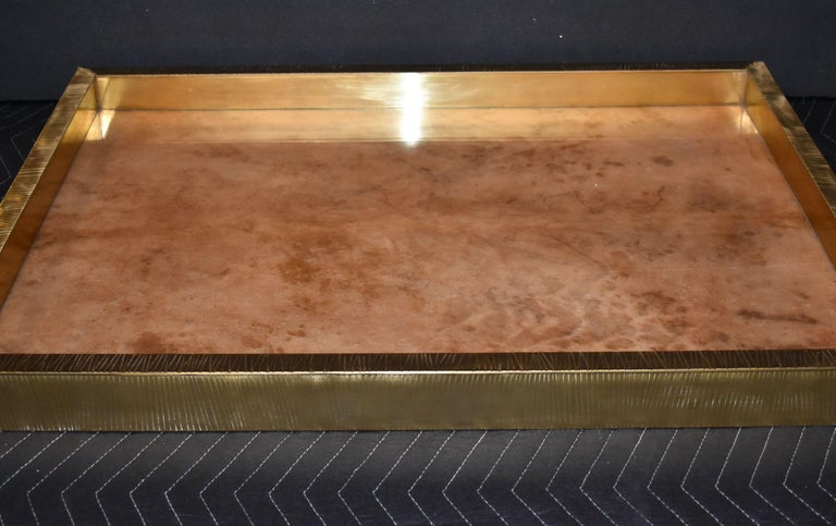 Brass polished trim cover with goatskin. Parchment is in varying shades of darker and lighter brown beige color. High gloss polyester resin filled finish.